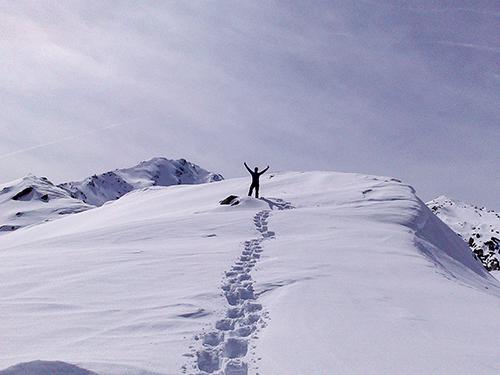 Montagne ski randonnée neige skieur montée sommet heureux Le Rogneux Suisse Valais